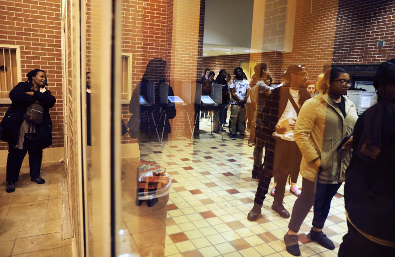 The reform bill aims to reduce voting problems, such asthe long lines seen at polling locations on Election Day, like this one in Fulton County, Georgia, on Nov. 6. (David Goldman/ASSOCIATED PRESS)