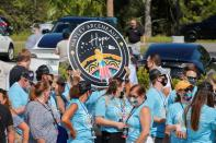 Crowd gathers to see Inspiration 4 civilian crew before they leave for lauch at SpaceX facility at the Kennedy Space Center