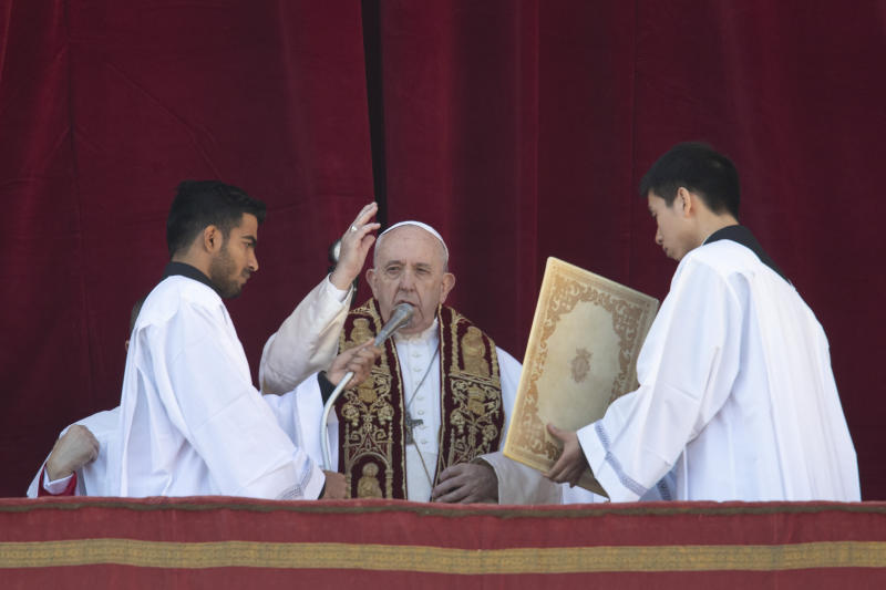 Pope Francis delivers the Urbi et Orbi (Latin for 'to the city and to the world' ) Christmas' day blessing from the main balcony of St. Peter's Basilica at the Vatican, Wednesday, Dec. 25, 2019. (AP Photo/Alessandra Tarantino)