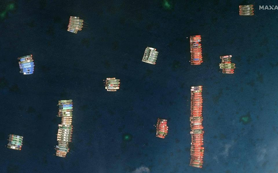 Chinese vessels anchored at the disputed Whitsun Reef in the South China Sea - AFP PHOTO / Satellite image/ Maxar Technologies