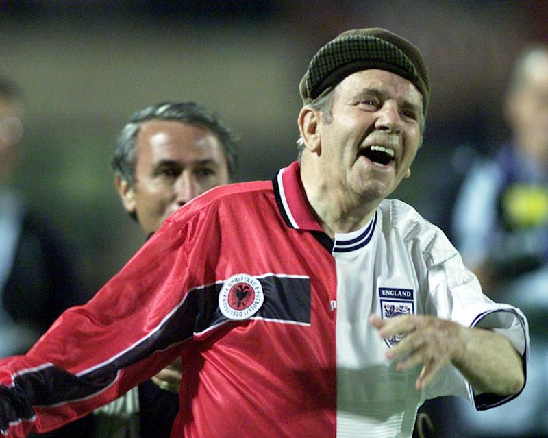 Sir Norman Wisdom entertaining the crowd during half time in the FIFA World Cup qualifier at the Quemal Stafe Stadium, Tirana, Albania. (Tom Hevezi/PA Archive/PA Images)