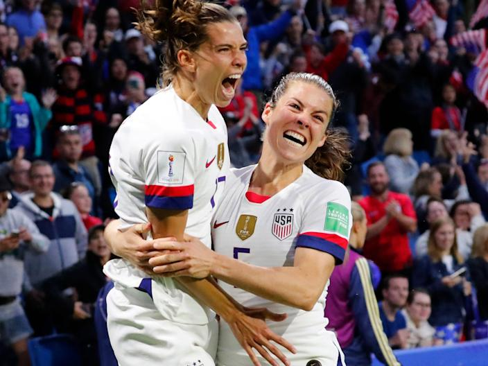 Tobin Heath (left) and Kelley O'Hara celebrate a USWNT goal during the 2019 World Cup.