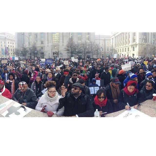 Protesters gather in Freedom Plaza before a march to the U.S. Capitol building in Washington, D.C., on Saturday, Dec. 13, 2014.