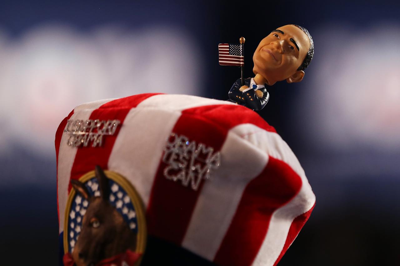 A person wears a hat with a bobblehead of Democratic presidential candidate, U.S. President Barack Obama during day one of the Democratic National Convention at Time Warner Cable Arena on September 4, 2012 in Charlotte, North Carolina. The DNC that will run through September 7, will nominate U.S. President Barack Obama as the Democratic presidential candidate.  (Photo by Justin Sullivan/Getty Images)