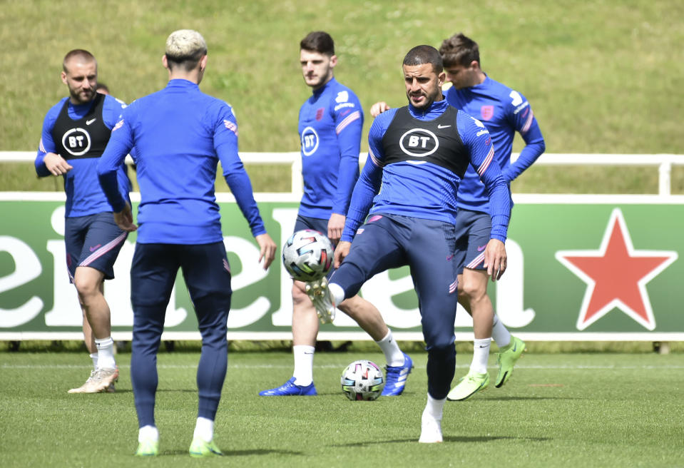 England's Kyle Walker, right, warms-up during a training session at St George's Park, Burton upon Trent, England, Monday July 5, 2021, ahead of their Euro 2020 soccer championship semifinal match against Denmark in London on Wednesday. (AP Photo/Rui Vieira)