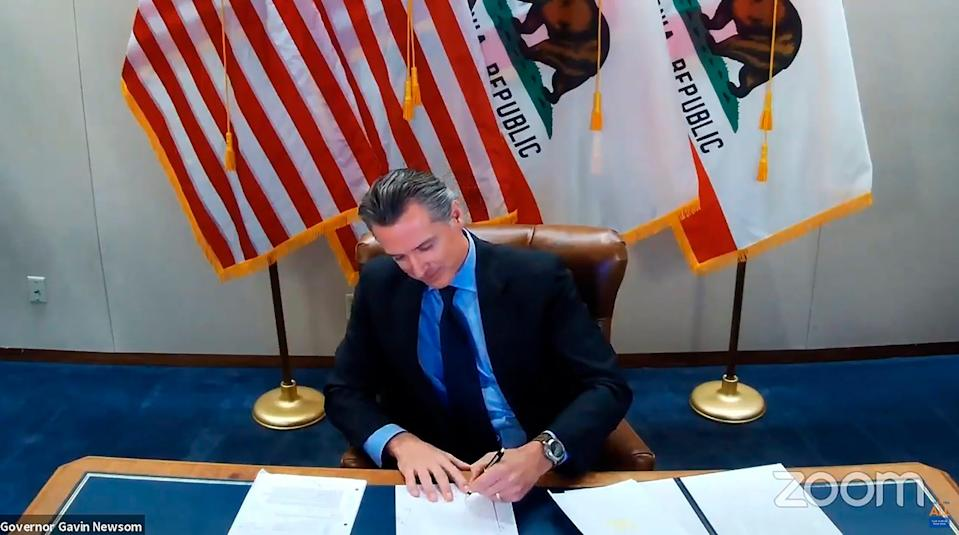 California Gov. Gavin Newsom signs into law a bill that establishes a task force to come up with recommendations on reparations for Black Americans.