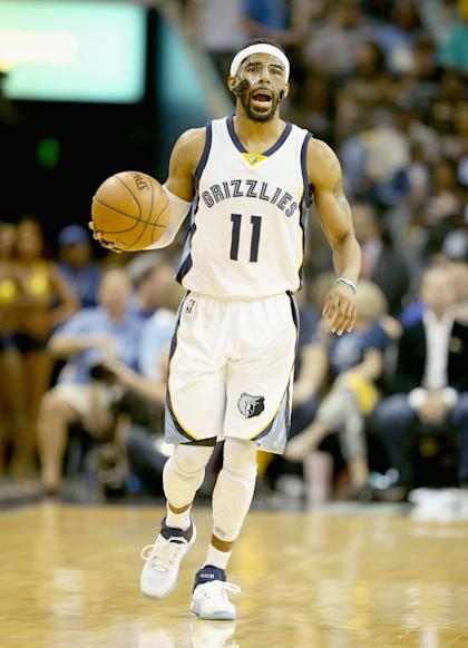 MEMPHIS, TN - MAY 15: Mike Conley #11 of the Memphis Grizzlies dribbles the ball against the Golden State Warriors during Game six of the Western Conference Semifinals of the 2015 NBA Playoffs at FedExForum on May 15, 2015 in Memphis, Tennessee.  NOTE TO USER: User expressly acknowledges and agrees that, by downloading and or using this photograph, User is consenting to the terms and conditions of the Getty Images License Agreement  (Photo by Andy Lyons/Getty Images)