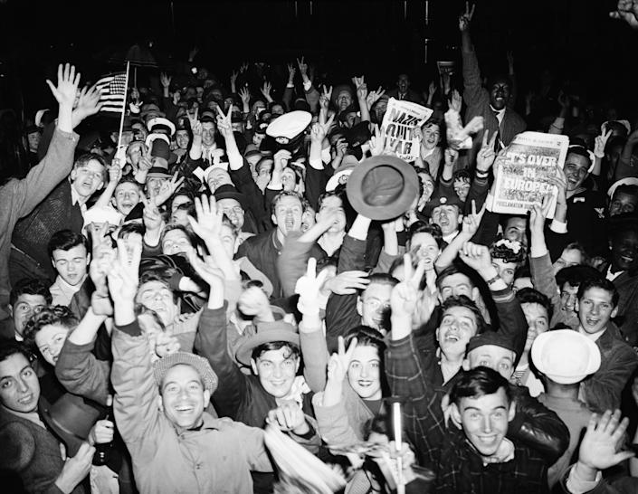 Crowds in New York celebrate the end of World War II in Europe on VE Day, 8th May 1945.