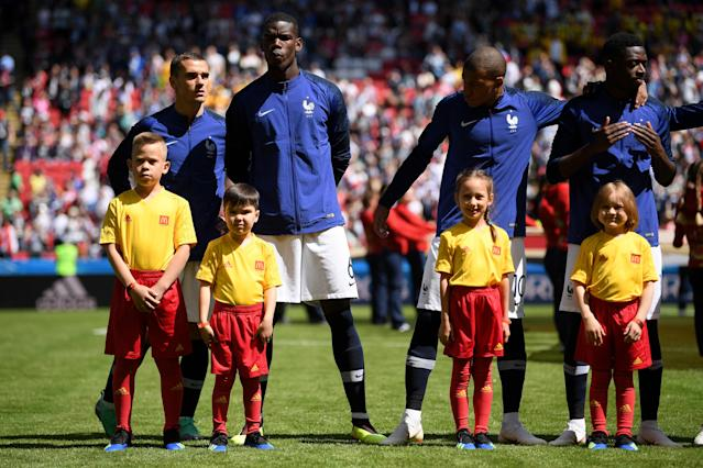 <p>The French players look on minutes before kick-off (getty) </p>