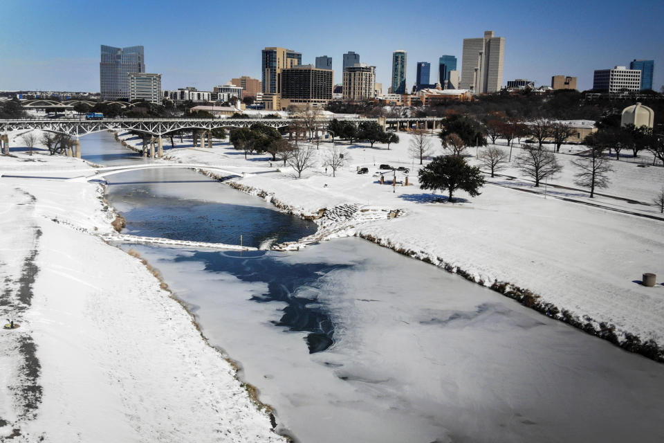 The Trinity River is mostly frozen after a snow storm Monday, Sept. 15, 2021, in Fort Worth, Texas. Source: AP