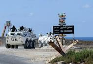 United Nations peacekeeping force (UNIFIL) vehicles patrol the Lebanese southern coastal area of Naqura by the border with Israel, on October 11