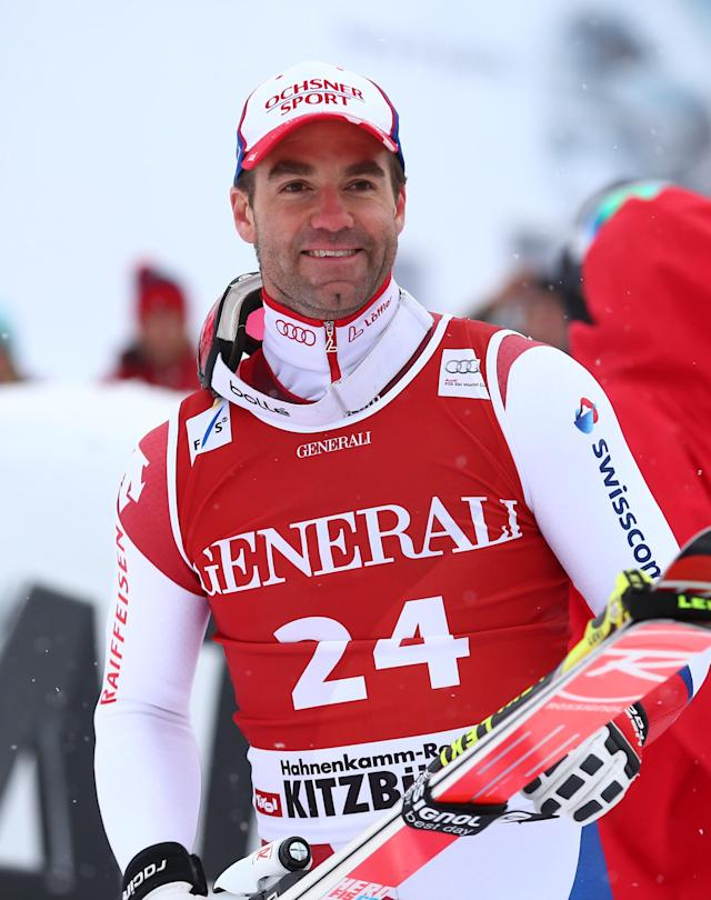 Didier Defago of Switzerland celebrates in the finish area after winning an alpine ski men's World Cup Super G in Kitzbuehel, Austria, Saunday, Jan. 26, 2014. (AP Photo/Giovanni Auletta)