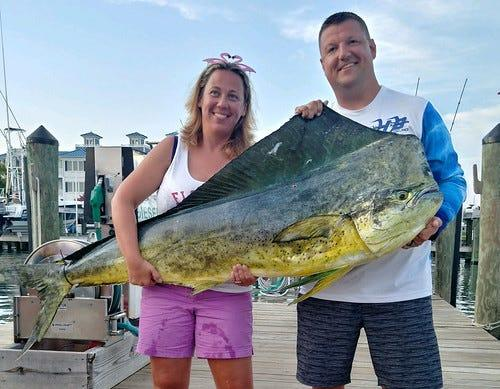 Kristy Frashure poses with a Maryland record-breaking 74.5-pound mahi-mahi caught on Aug. 16 at the Poor Girls Open in Ocean City.