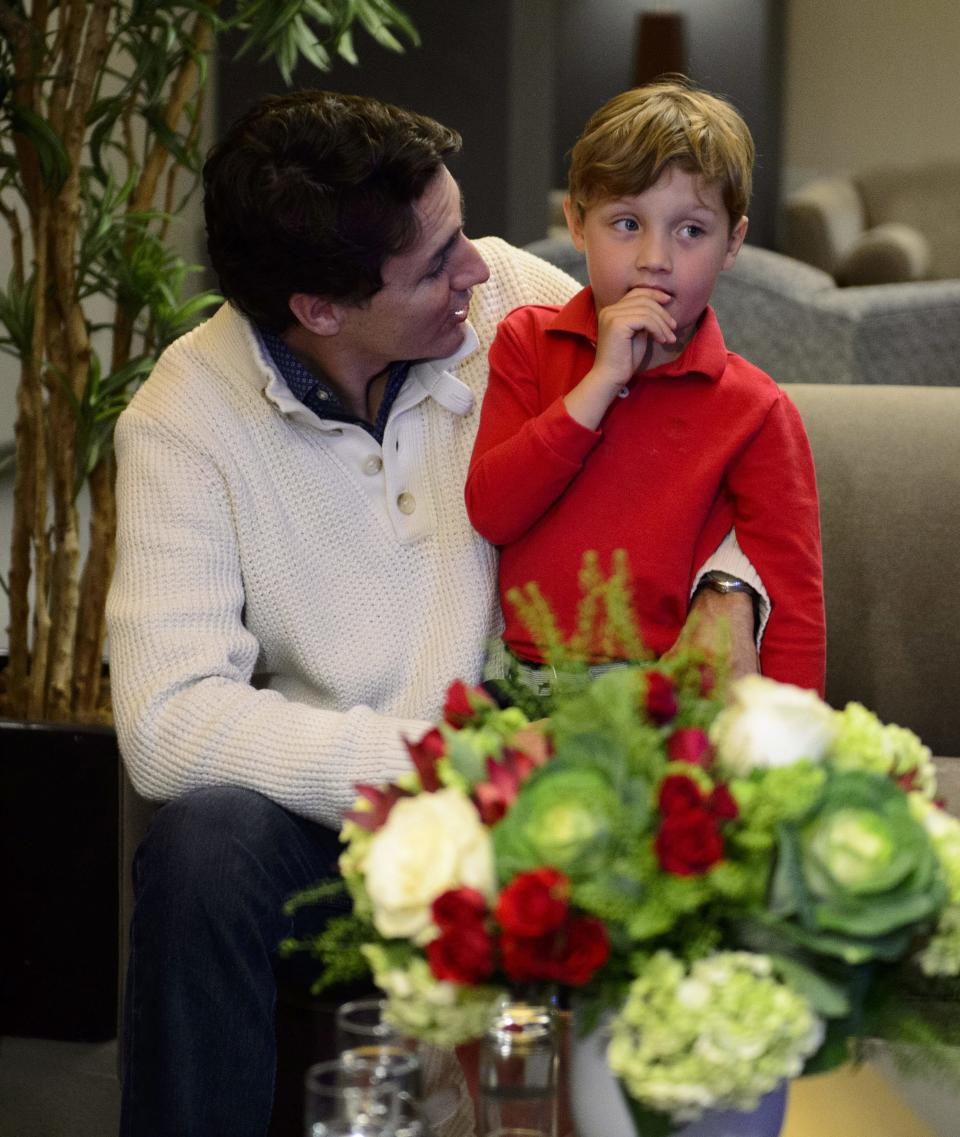 Liberal leader Justin Trudeau and his son Hadrien watch election results in Montreal on Monday Oct. 21, 2019. THE CANADIAN PRESS/Sean Kilpatrick