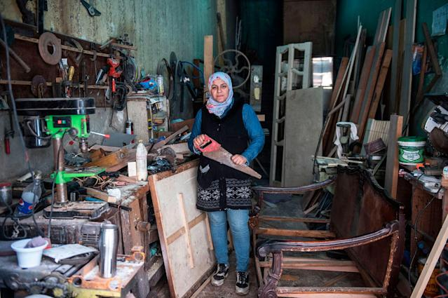 <p>Asmaa Megahed, a 31-year-old Egyptian carpenter, poses for a picture at her workshop in Abdeen district in downtown Cairo, Egypt, on February 26, 2018. (Photo: Khaled Desouki/AFP/Getty Images) </p>