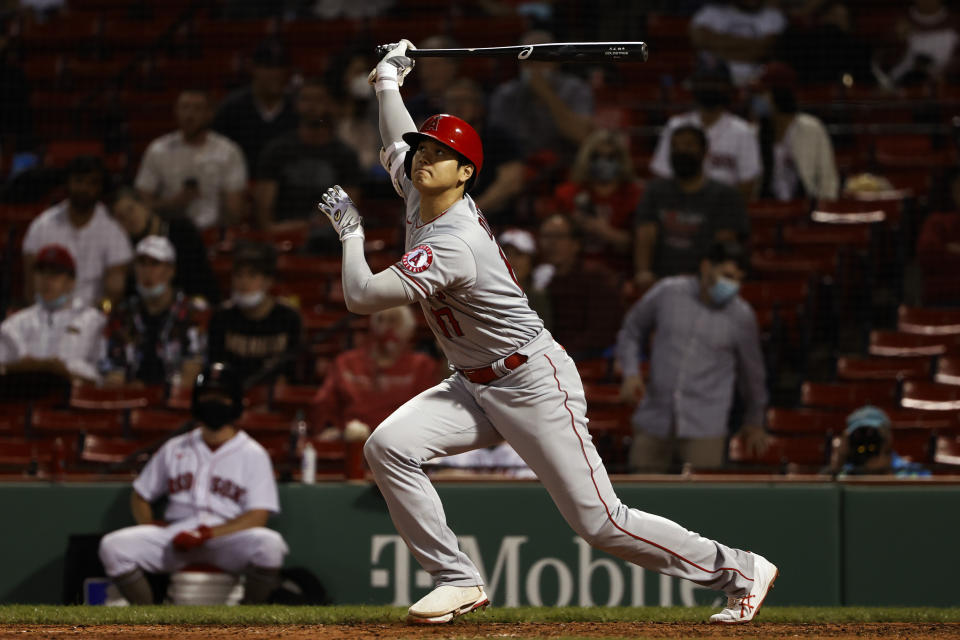 Los Angeles Angels' Shohei Ohtani watches his solo home run against the Boston Red Sox during the sixth inning of a baseball game Friday, May 14, 2021, at Fenway Park in Boston. (AP Photo/Winslow Townson)