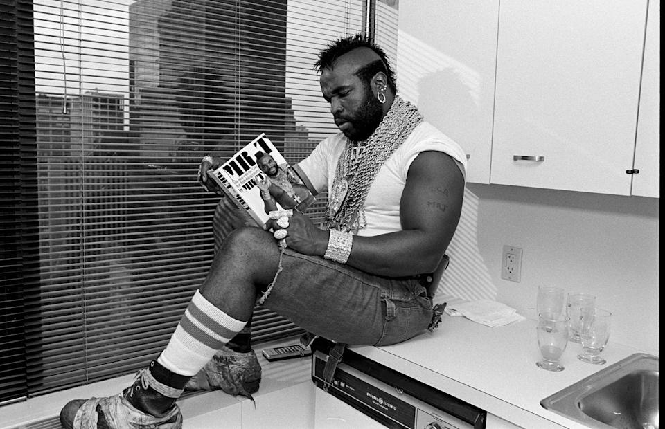 <p>Look: Mr. T can wear whatever the hell he wants—including cut-off carpenter jeans—while reading his own autobiography, <em>Mr. T.</em></p>