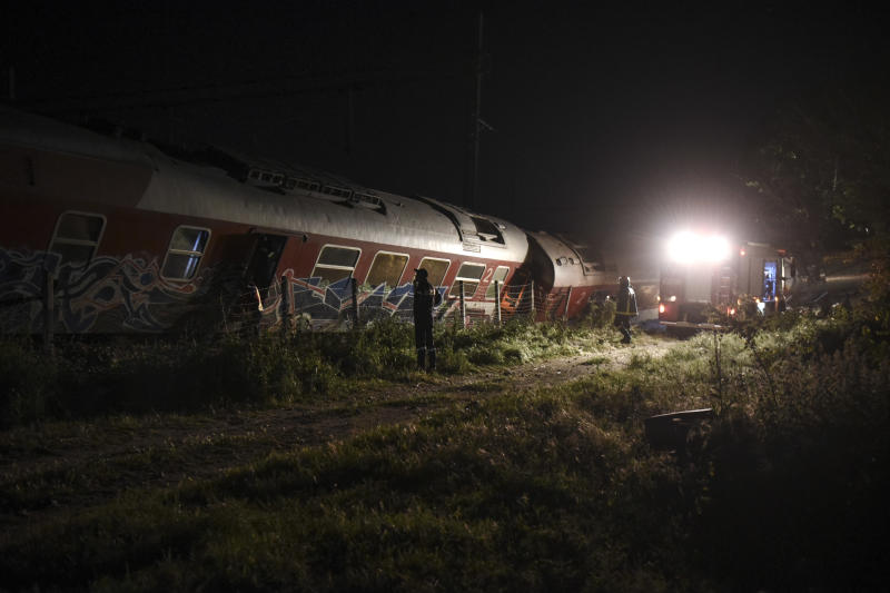 Rescuers search the site of a fatal train derailment close to the northern city of Thessaloniki, Greece on Sunday, May 14, 2017. The train was traveling on the Athens-Thessaloniki route when it went off the rails near the station at the village of Adendro, 40 kilometers (25 miles) west of Thessaloniki Saturday night. (AP Photo/Giannis Papanikos)