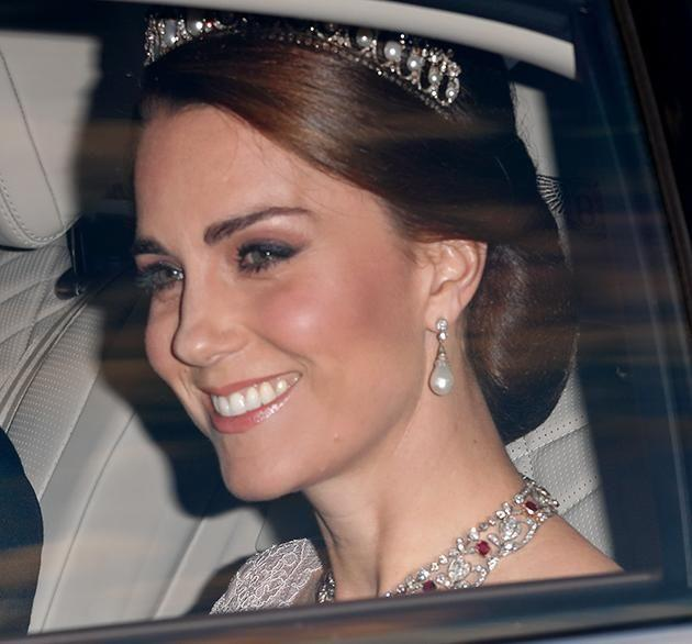 Earlier in the evening, the Duchess was pictures smiling at the cameras. Photo: Getty Images