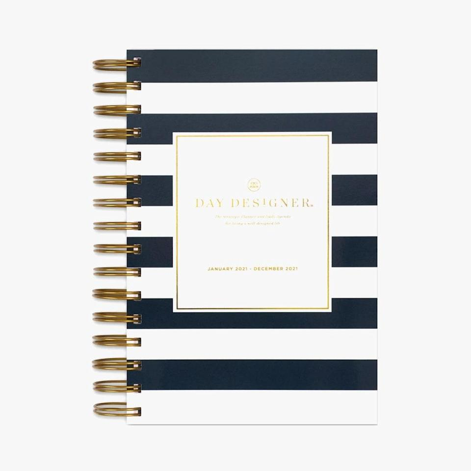 """$25, BLUE SKY. <a href=""""https://www.bluesky.com/collections/day-designer-3/products/2021-daily-planner-black-stripe-5-x-8-by-day-designer"""" rel=""""nofollow noopener"""" target=""""_blank"""" data-ylk=""""slk:Get it now!"""" class=""""link rapid-noclick-resp"""">Get it now!</a>"""