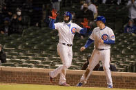 Chicago Cubs' shortstop Javier Baez (9) and first baseman Anthony Rizzo (44) celebrate scoring against the New York Mets during the fourth inning of a baseball game Wednesday, April 21, 2021, in Chicago. (AP Photo/Mark Black)