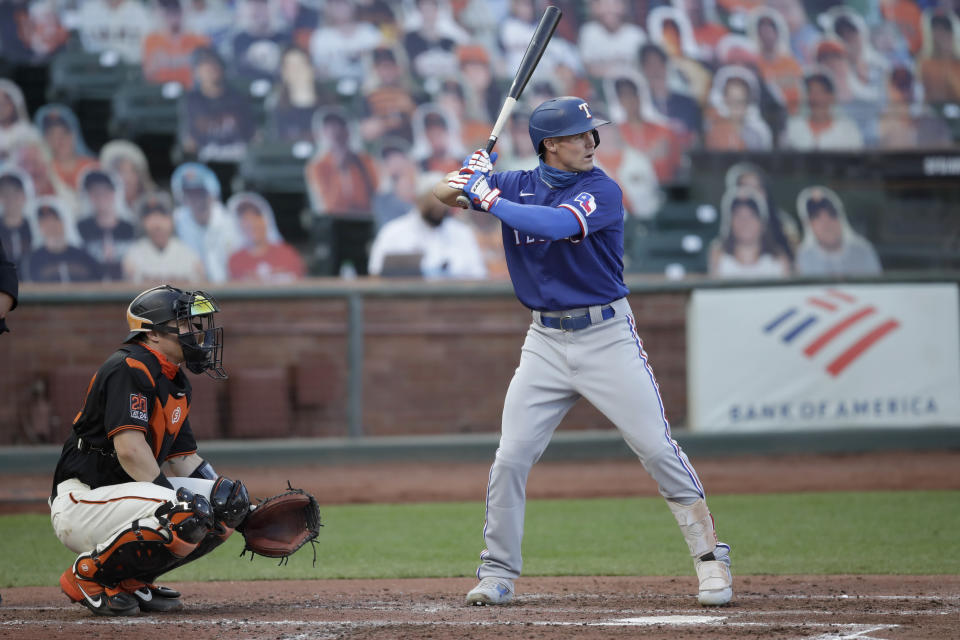 Texas Rangers' Scott Heineman, right, waits for the pitch as his brother, San Francisco Giants catcher Tyler Heineman, left, gives a signal during the second inning of a baseball game Saturday, Aug. 1, 2020, in San Francisco. (AP Photo/Ben Margot)