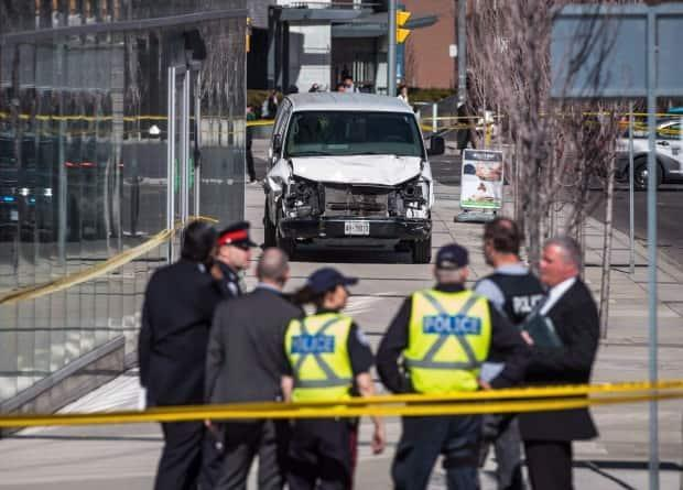 Police are seen near a damaged van in Toronto after a man intentionally drove it onto a sidewalk and into a number of pedestrians on Monday, April 23, 2018. A judge found Alek Minassian guilty of multiple counts of murder and attempted murder Wednesday. (Aaron Vincent Elkaim/The Canadian Press - image credit)