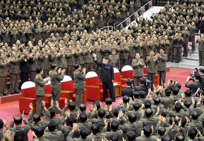 North Korean leader Kim Jong Un waves during a performance by the State Merited Chorus in this undated photo released by North Korea's Korean Central News Agency (KCNA) in Pyongyang November 22, 2013. REUTERS/KCNA/Handout via Reuters (NORTH KOREA - Tags: POLITICS) ATTENTION EDITORS - THIS PICTURE WAS PROVIDED BY A THIRD PARTY. REUTERS IS UNABLE TO INDEPENDENTLY VERIFY THE AUTHENTICITY, CONTENT, LOCATION OR DATE OF THIS IMAGE. FOR EDITORIAL USE ONLY. NOT FOR SALE FOR MARKETING OR ADVERTISING CAMPAIGNS. THIS PICTURE IS DISTRIBUTED EXACTLY AS RECEIVED BY REUTERS, AS A SERVICE TO CLIENTS. NO THIRD PARTY SALES. NOT FOR USE BY REUTERS THIRD PARTY DISTRIBUTORS. SOUTH KOREA OUT. NO COMMERCIAL OR EDITORIAL SALES IN SOUTH KOREA