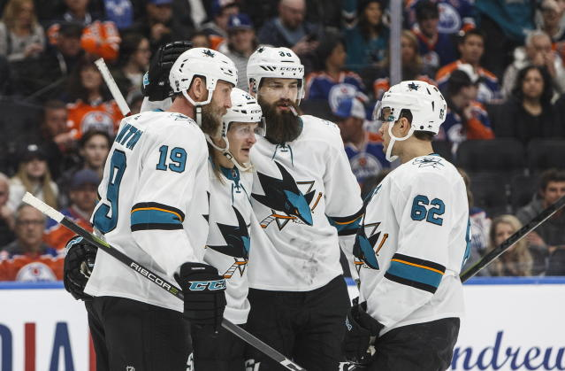 San Jose Sharks' Joe Thornton (19), Marcus Sorensen (20), Brent Burns (88) and Kevin Labanc (62) celebrate a goal against the Edmonton Oilers during the first period of an NHL hockey game Thursday, April 4, 2019, in Edmonton, Alberta. (Jason Franson/The Canadian Press via AP)