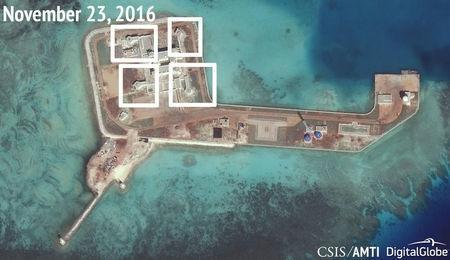 A satellite image shows what CSIS Asia Maritime Transparency Initiative says appears to be anti-aircraft guns and what are likely to be close-in weapons systems (CIWS) on the artificial island Hughes Reef in the South China Sea in this image released on December 13, 2016. Courtesy CSIS Asia Maritime Transparency Initiative/DigitalGlobe/Handout via REUTERS