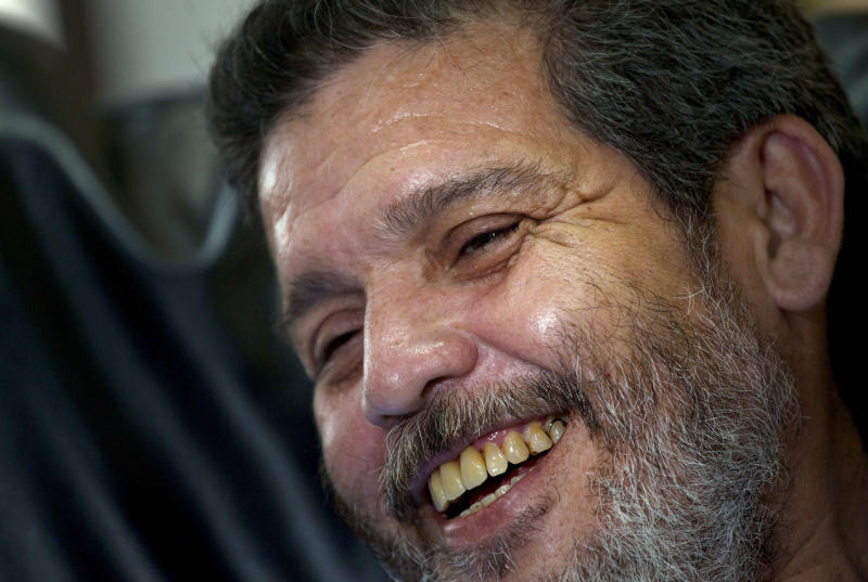 Marco Leon Calarca, spokesman and member of the Revolutionary Armed Forces of Colombia (FARC) smiles during an interview in Havana, Cuba, Friday, Sept 7, 2012. The spokesman for Colombia's main leftist guerrilla army says President Juan Manuel Santos' rejection of a cease-fire will not derail peace talks next month. (AP Photo/Ramon Espinosa)