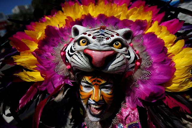 "<p>A member of the ""Congo Reformado"" folk group poses for a portrait before a parade at the 12th International Festival of the Iberian Mask in Lisbon, Portugal May 5, 2017. (Photo: Rafael Marchante/Reuters) </p>"