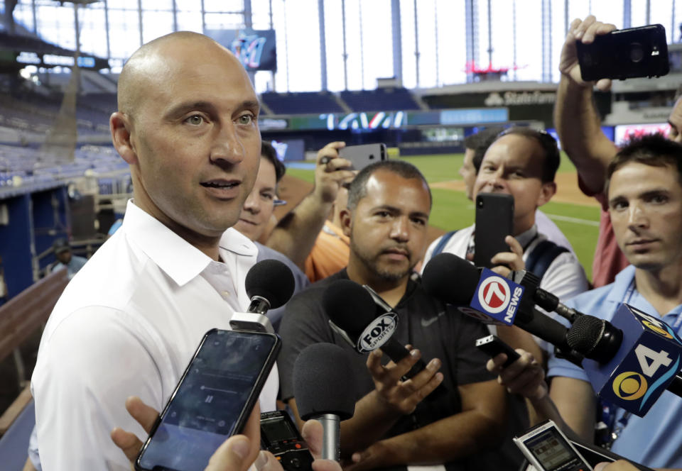 FILE - In this May 3, 2019, file photo, Miami Marlins CEO Derek Jeter talks with reporters before a baseball game against the Atlanta Bravesin Miami. Marlins CEO Derek Jeter told team employees during a conference call Monday, April 20, 2020, he is forgoing his salary during the coronavirus pandemic, a person familiar with the discussions told The Associated Press. The person confirmed Jeter's comments to the AP on condition of anonymity because the Marlins have not commented publicly on the call. (AP Photo/Lynne Sladky, File)