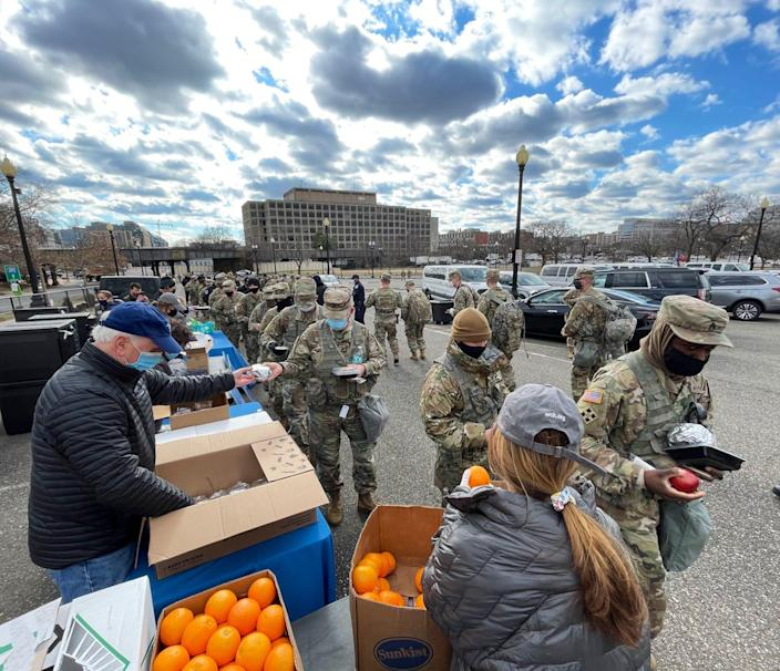 World Central Kitchen staff hand out meals to National Guard members in Washington, D.C.