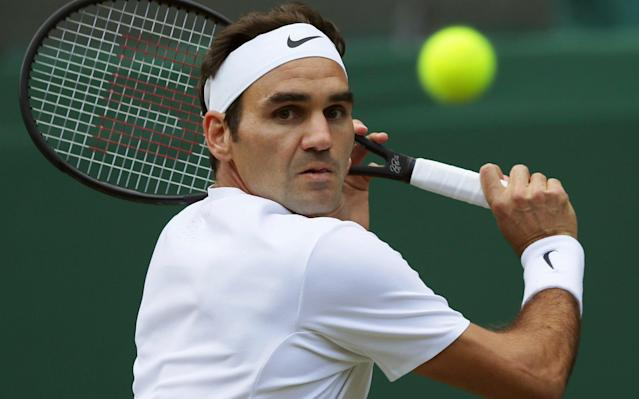 <span>Federer won his 100th match at Wimbledon at a canter</span> <span>Credit: AP Photo/Tim Ireland </span>