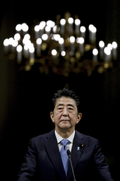 Japanese Prime Minister Shinzo Abe listens during a joint press conference with Iranian President Hassan Rouhani after their meeting at the Saadabad Palace in Tehran, Iran, Wednesday, June 12, 2019. The Japanese leader is in Tehran on an mission to calm tensions between the U.S. and Iran. (AP Photo/Ebrahim Noroozi)