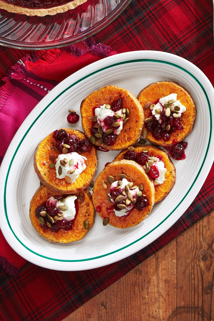 """<p>These elegant medallions look beautiful on the plate, and the combo of creamy cheese, crunchy pumpkin seeds, and sweet poached cranberries is irresistible. </p><p><strong><a href=""""https://www.countryliving.com/food-drinks/a29628010/roasted-squash-with-goat-cheese-and-poached-cranberries-recipe/"""" rel=""""nofollow noopener"""" target=""""_blank"""" data-ylk=""""slk:Get the recipe"""" class=""""link rapid-noclick-resp"""">Get the recipe</a>.</strong> </p>"""