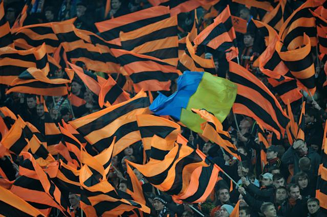 Fans of FC Shakhtar wave flags of their team during the UEFA Champions League Group G football match against Zenit St Petersburg in Donetsk on October 19, 2011. AFP PHOTO/ SERGEI SUPINSKY (Photo credit should read SERGEI SUPINSKY/AFP/Getty Images)