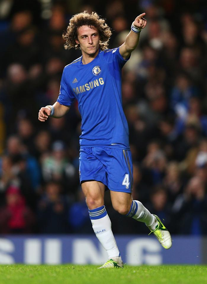LONDON, ENGLAND - DECEMBER 23:  David Luiz of Chelsea celebrates as he scores their second goal during the Barclays Premier League match between Chelsea and Aston Villa at Stamford Bridge on December 23, 2012 in London, England.  (Photo by Clive Rose/Getty Images)
