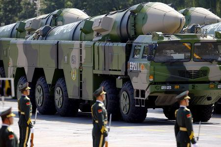 FILE PHOTO - Military vehicles carrying DF-21D ballistic missiles roll to Tiananmen Square during a military parade to mark the 70th anniversary of the end of World War Two, in Beijing, China, September 3, 2015.    REUTERS/Damir Sagolj/File Photo