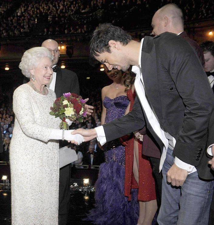 <p>Enrique, you couldn't change out of your jeans to meet the Queen!? Her Majesty didn't really seem to mind the fashion faux pas, so Enrique really must be <em>that</em> cute IRL.</p>