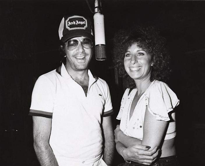 """<p>Long before they were dominating the Billboard charts and giving us classics like """"Sweet Caroline"""" and """"The Way He Makes Me Feel,"""" Neil Diamond and Barbra Streisand were singing through the halls of Erasmus Hall High School in Brooklyn, New York. Did they have any idea that their talents would make them into music royalty? Maybe, maybe not. """"We were two poor kids in Brooklyn,"""" Diamond <a href=""""https://www.asliceofbrooklyn.com/blog/go-back-to-school-with-famous-erasmus-hall-high-alumni/"""" rel=""""nofollow noopener"""" target=""""_blank"""" data-ylk=""""slk:recalled"""" class=""""link rapid-noclick-resp"""">recalled</a> of his and Streisand's time at Erasmus. """"We hung out in the front [of the school] and smoked cigarettes."""" </p><p>The classmates joined forces in 1978 to create one of the saddest breakup songs of all time, <a href=""""https://www.youtube.com/watch?v=Z3yu2c-0_w4"""" rel=""""nofollow noopener"""" target=""""_blank"""" data-ylk=""""slk:&quot;You Don't Bring Me Flowers.&quot;"""" class=""""link rapid-noclick-resp"""">""""You Don't Bring Me Flowers.""""</a></p>"""