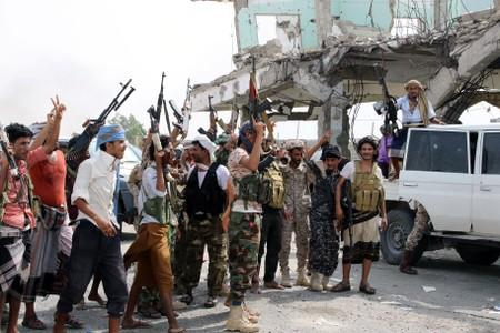 Southern separatist fighters are pictured during clashes with government forces in Aden