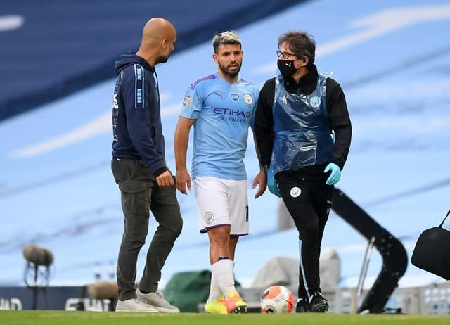 Sergio Aguero limped off just before half-time (PA)