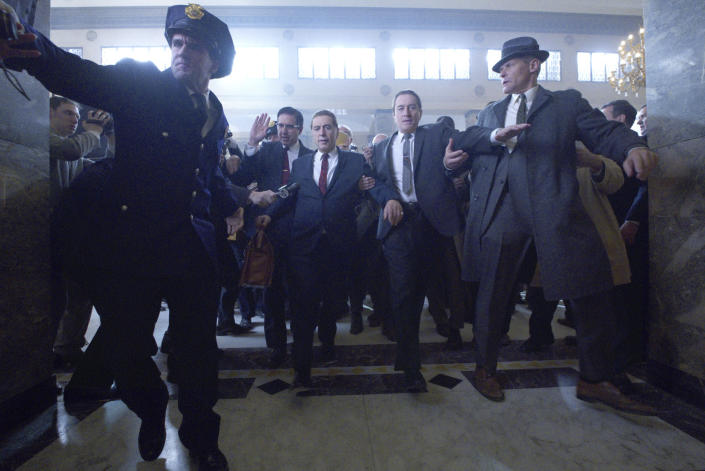 """This image released by Netflix shows Al Pacino, center left, and Robert De Niro, center right, in a scene from """"The Irishman."""" (Netflix via AP)"""