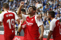 Sevilla's Nolito, centre, celebrates with team mates after scoring his side's second goal during the Spanish La Liga soccer match between Espanyol and Sevilla at the RCDE Stadium in Barcelona, Spain, Sunday Aug.18, 2019. (AP Photo/Joan Monfort)