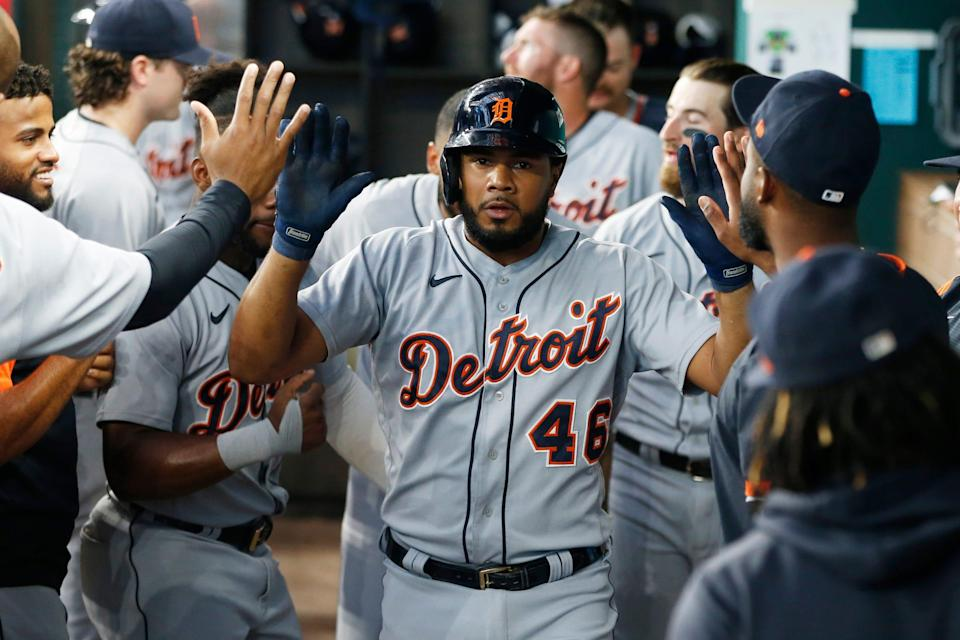 Detroit Tigers third baseman Jeimer Candelario (46) is congratulated in the dugout after hitting a home run in the fourth inning against the Texas Rangers at Globe Life Field. Wednesday, June 7, 2021.