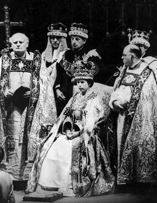 Queen Elizabeth II prepares to receive homage after her coronation ceremony in Westminster Abbey, London, in this June 2, 1953, file photo. Michael Ramsey (1904-1988), the Bishop of Durham, is on the left, and Harold William Bradfield (1898 -1960), the bishop of Bath and Wells, is on the right.