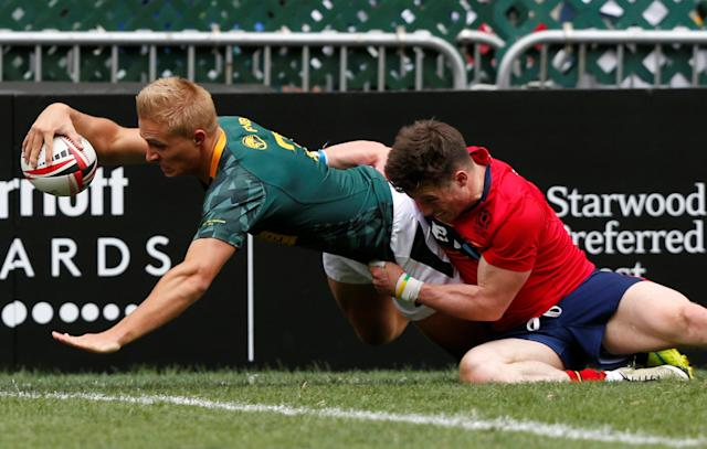 Rugby Union - Hong Kong Sevens - South Africa v Scotland - Hong Kong Stadium, Hong Kong, China - April 7, 2018 South Africa's Marco Labuschagne scores a try. REUTERS/Bobby Yip