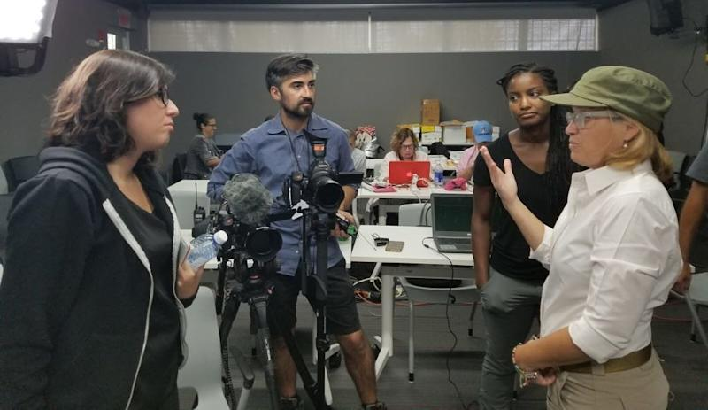 The author (left) and members of HuffPost's video team speak with San Juan Mayor Carmen Yulín Cruz Soto in October 2017.